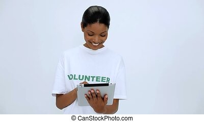 Volunteer woman using tablet pc on white background