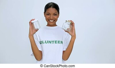 Volunteer woman showing two jar on white background