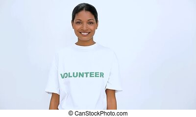 Volunteer woman does sign at camera on white background