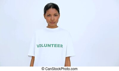 Volunteer woman crossed her arms on white background