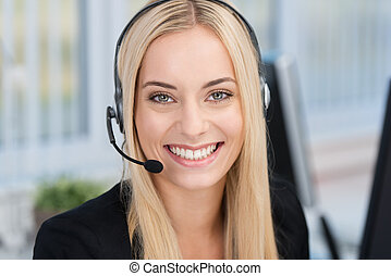 Smiling woman wearing a headset - Smiling young business...