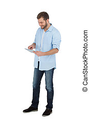 Relaxed male model using his tablet pc