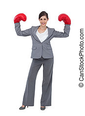 Businesswoman with red boxing gloves