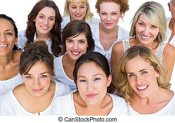 Positive models smiling at camera on white background