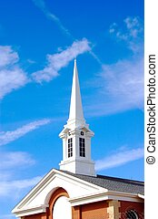 Pointing up - Church steeple with blue sky and clouds