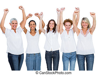 Smiling casual models posing with hands up on white...