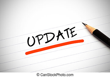 The word update written on notepad - The word update written...