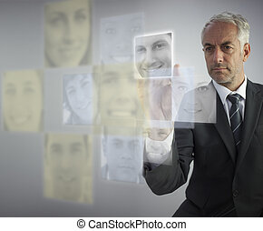 Stern human resources director selecting future employees on...
