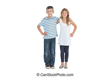 Happy young brother and sister holding each other