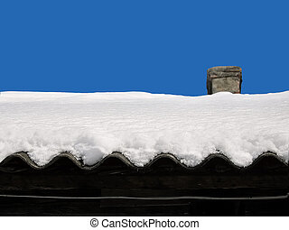 snow on a roof of the old house - Layer of snow on a roof of...