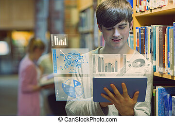 Young man studying on his digital tablet computer in a...