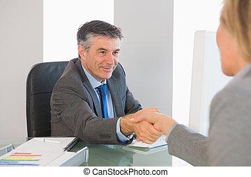 Pleased businessman - Pleased mature businessman shaking the...