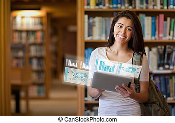 Smiling student working on her futuristic tablet in...