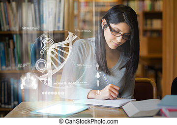 Focused mature student studying medicine on digital...