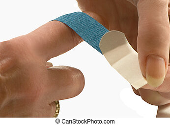 PUTTING A BANDAGE ON A CUT