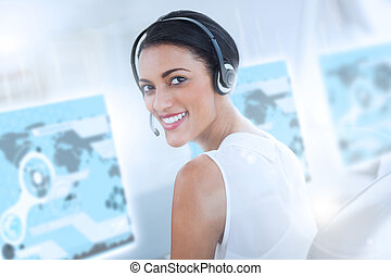 Pretty call center employee using futuristic interface...