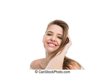 Bare natural woman smiling at camera  on white background