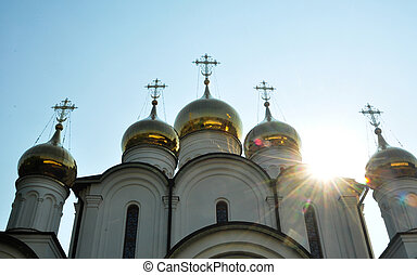 Orthodox temple with sun blick contrast. Crosses and heaven.