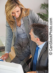Business team having a conversation in an office - A smiling...