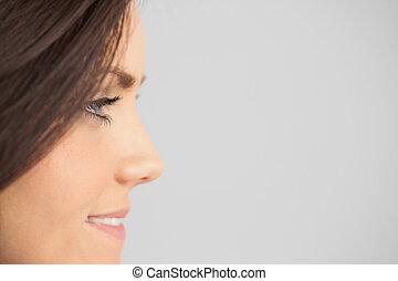 Smiling brunettte looking away