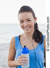 Smiling woman holding her bottle