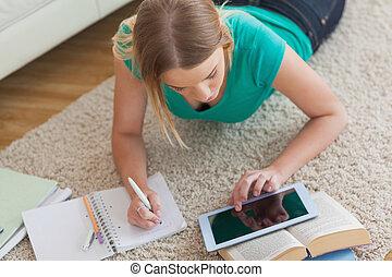 Blonde woman lying on floor - Blonde woman lying on floor...
