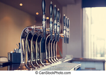 Beer taps in a pub