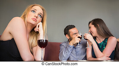 Blonde woman feeling jealous of two people are flirting...