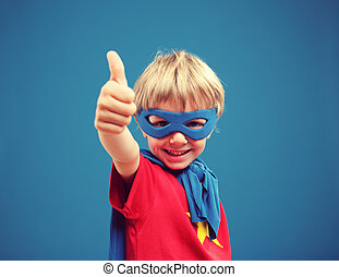 Little Superhero - A young boy superhero giving you a thumbs...