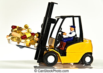 Fork lift and tablets - A toy fork lift truck lifting a...