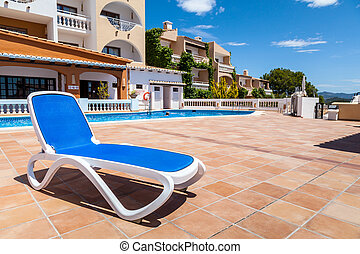Deck Chair in a Swimming Pool