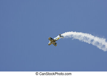 A Model Airplane doing a Loop while trailing smoke
