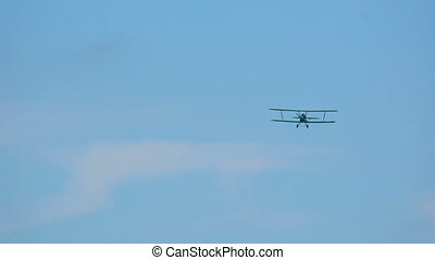Biplane - Green biplane flying by at the Mochishe airshow,...
