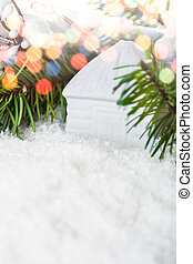White house toy in the snow and fir tree. Christmas postcard...