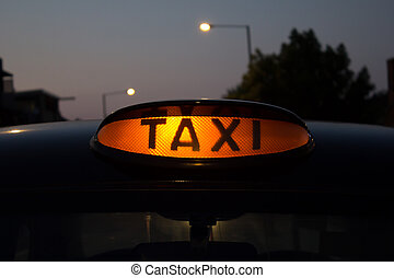 Taxi for hire sign - The sign for a taxi that is available...