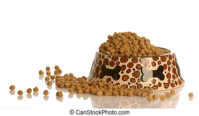 full bowl of dog food - bowl of dog kibble in a heart shaped...