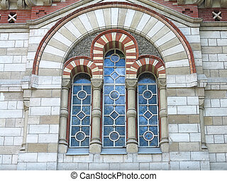 Ancient tall gothic stained glass window in the medieval...