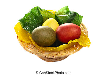 Easter eggs - Easterbasket with colorful eggs isolated on...
