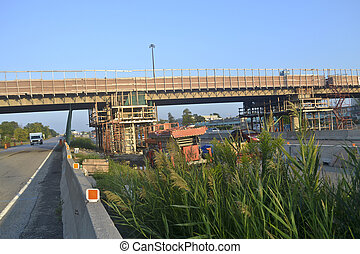 Bridge re-construction. - The re-construction and repair of...