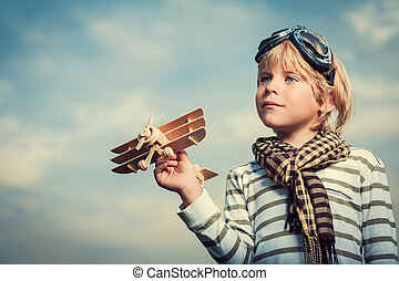 Boy with wooden plane - Little boy with wooden plane