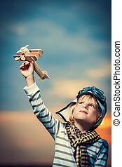 Leisure - Little boy with wooden plane