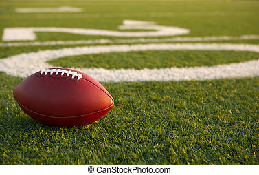 American Football near the Twenty Yard Line with room for...