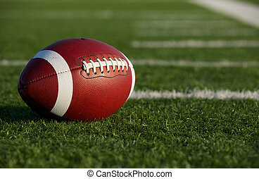 ollegiate Football on the Field - Collegiate Football on the...