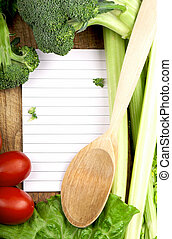 fresh vegetables on the wooden background and paper for...