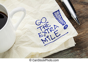 go the extra mile - motivational slogan on a napkin with a...