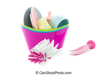doing the dishes - pink brush and porcelain isolated on...