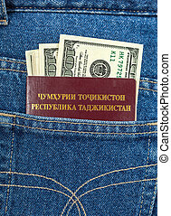 Tajikistan passport and dollar bills in the back jeans...