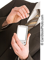 Business man using a pda isolated on white