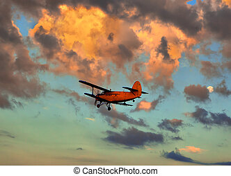 small plane against the sky on a decline