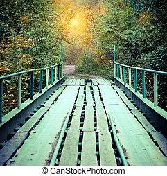 Old bridge in autumn misty park - Autumn time. Old bridge in...